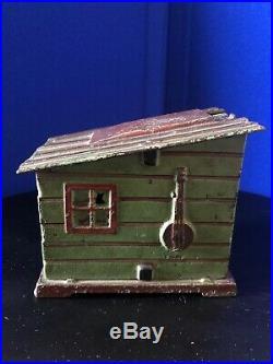 1885 Cabin Mechanical Cast Iron Bank Black Americana, J. E. Stepehns