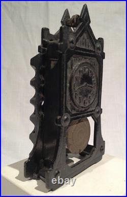 ARCADE IRON CLOCK STILL BANK with MOVABLE PENDULUM, C. 1923, ALL ORIGINAL