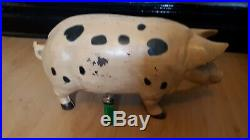 A Large Cast Iron Pig Money Box Piggy Bank shop display
