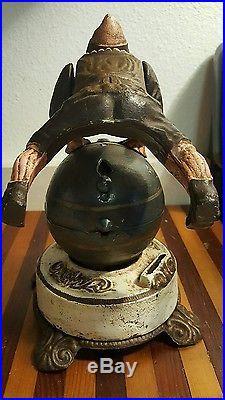 Antique Cast Iron Mechanical Bank Clown On A Globe