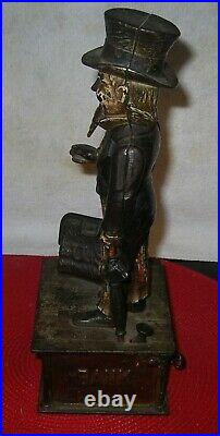 Antique Cast Iron Uncle Sam Mechanical Bank Shepard Hardware withKey June 8 1886