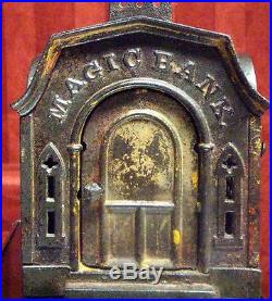 Antique MECHANICAL MAGIC BANKCast Iron Pat. Mar 7 1876Authentic & working