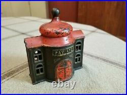 Antique cast iron mechanical presto bank