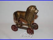 Cast Iron Lion On Wheels Still Bank