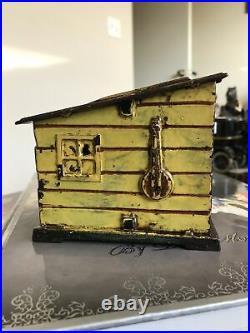 Cabin Bank Cast Iron Mechanical Bank, J E Stevens