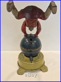 Clown On Globe Cast Iron Mechanical Bank J&E Stevens