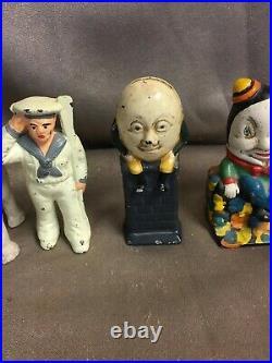Collection of Six Antique Cast Iron Banks Humpy Dumpy, Saluting Sailor, & More