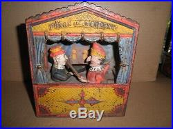 Great old original cast iron Punch and Judy Mechanical Penny Bank c. 1884 1906