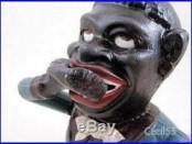 JOLLY N EATS COIN ROLLS EYES CAST IRON MECHANICAL BANK SHIPS FREE
