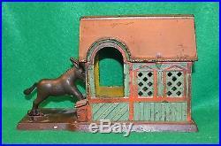 J E Stevens Cast Iron Mechanical Bank, Mule Entering The Barn Bank
