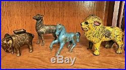 Lot of 4 Antique Cast Iron Still Bank AnimalsLion, Horse, Elephant, Deer