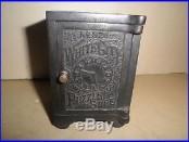Niceold original cast ironTime Lock Puzzle Safe #326 still bank 1893