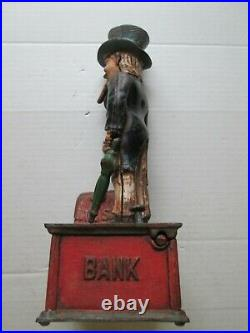 ONE (1) ORIGINAL CAST IRON 1920s UNCLE SAM WORKING MECHANICAL BANK, as seen
