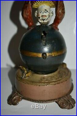 Original Clown On Globe Cast Iron Mechanical Bank, Great Paint 1890 No Reserve