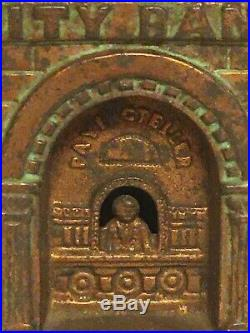 Original cast iron City Bank with Teller still bank by Judd c. 1880's