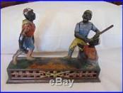 Rare J. & E. Stevens Original Cast Iron Dark Town Battery Mechanical Bank
