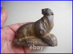 Rare antique Arcade painted cast Iron Seal on Rock Bank. Antique C. I. Bank