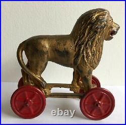 SCARCE c. 1920's A. C. Williams Lion On Wheels Cast Iron Bank Largest Size