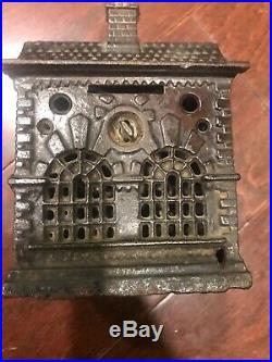 Two Cast Iron Banks One (A. C Williams) And One (Kenton)