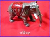 VINTAGE CAST IRON ELEPHANT BANK CURLED TRUNK PAINTED SADDLE HIDDEN BANK