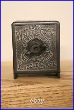 White City No 357 cast iron puzzle safe bank